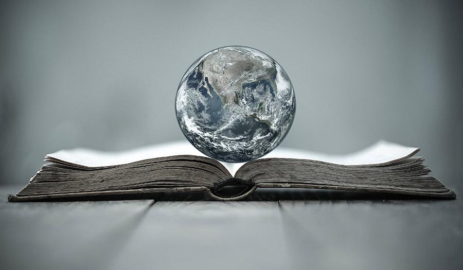 Globe_On_Bible-apha-210624.jpg