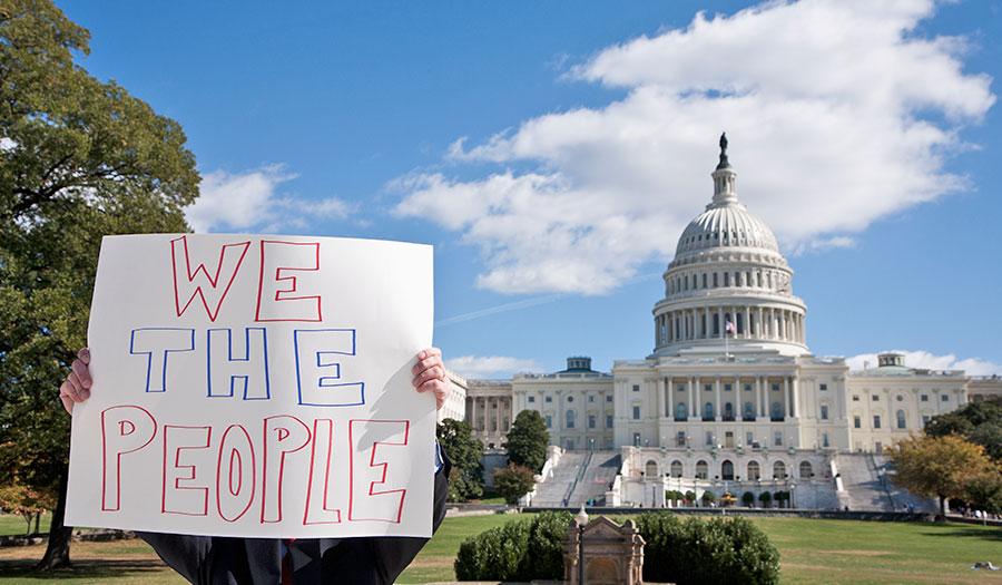 protestor_placard_whitehouse-apha-180615.jpg